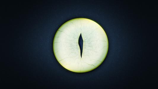 在黑色背景上的圆形绿色的眼睛