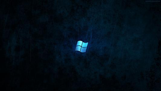 在蓝色黑色背景上的蓝色Microsoft Windows徽标