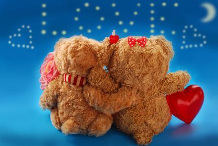两个爱的小熊玩具题字爱的背景上