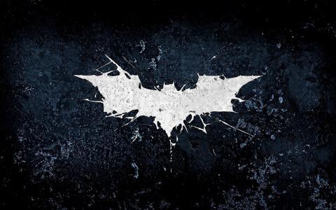 在黑色背景上的白色蝙蝠符号