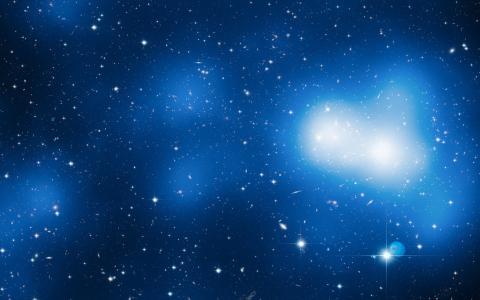星星和星系在蓝色的空间