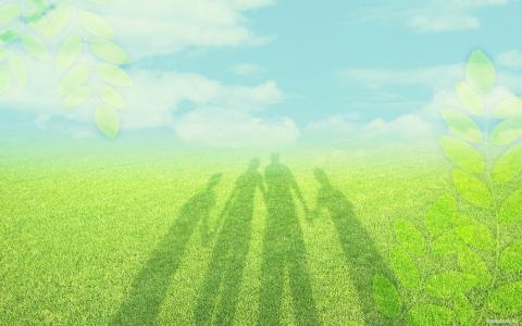 在草地上的家庭影子