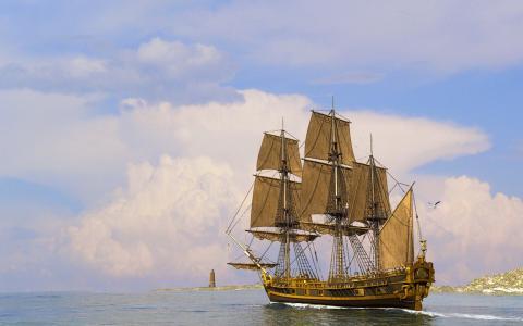 由灯塔的帆船