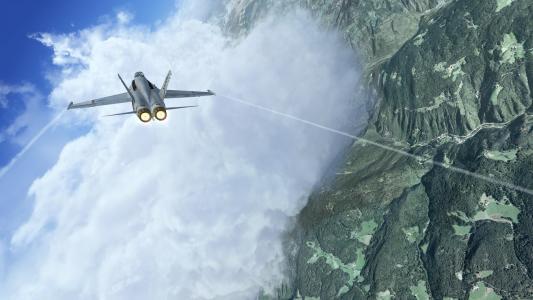 战斗机飞过山上的云