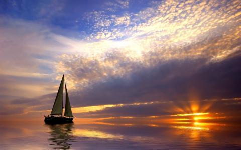 帆船在日落时平静的海面